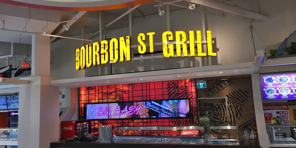 Digital Menu Board Video Wall Impact and attracting customers showing videos covering multiple screens at Bourbon St Grill located in Tsawwassen Mills Outlet Mall, British Columbia
